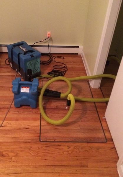 Water Mitigation using Special Drying Equipment to Save Wood Floor in Cos Cob, CT (1)